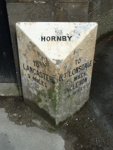 Hornby lies at the crossing of the River Wenning on the road between Lancaster and Kirby Lonsdale.