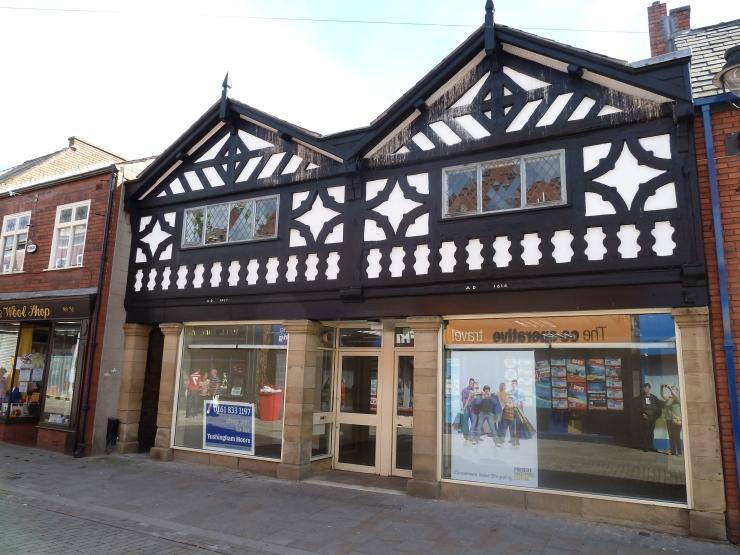 Prescot has buildings dated 1614.
